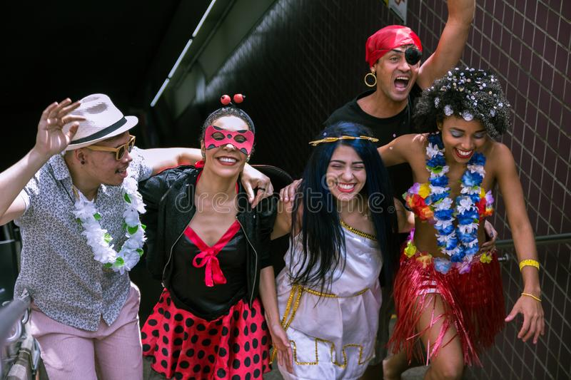 Carnaval party. Crowd of Brazil people in costume in the city Carnival. Dressed brazilian celebrating in parade festival stock image