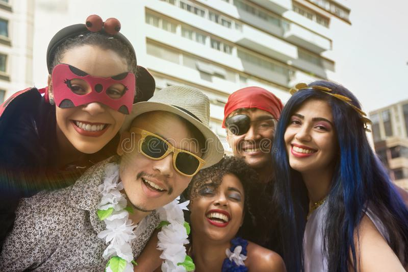 Carnaval party. Crowd of Brazil people in costume in the city Carnival. Dressed brazilian celebrating in parade festival. Carnaval party. Crowd of Brazil people stock photography