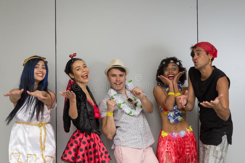 Carnaval party. Dressed Brazil people going to street Carnival. Happy brazilian partygoers in costume celebrating in parade. Carnaval party. Dressed crowd of stock photo