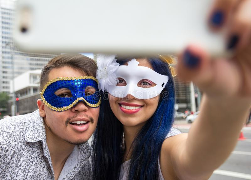 Carnaval party. Dressed Brazil people going to street Carnival. Happy brazilian partygoers in costume celebrating in parade. Carnaval party. Dressed crowd of royalty free stock images