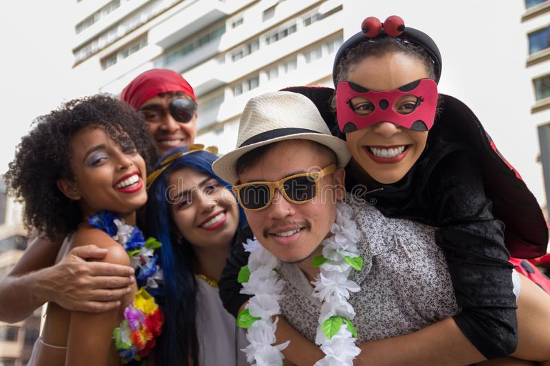 Carnaval party. Dressed Brazil people going to street Carnival. Happy brazilian partygoers in costume celebrating in parade stock images