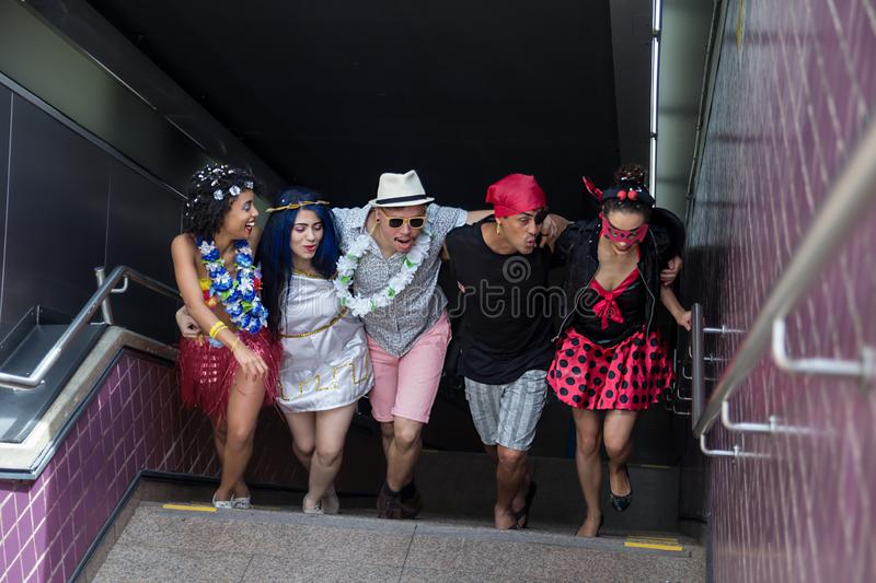 Carnaval party. Dressed Brazil people going to street Carnival. Happy brazilian partygoers in costume having fun in parade stock image