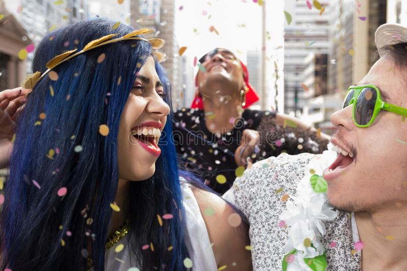 Carnaval party. Dressed group of Brazil friends going to street Carnival. Happy brazilian partygoers in costume in parade festival stock photos