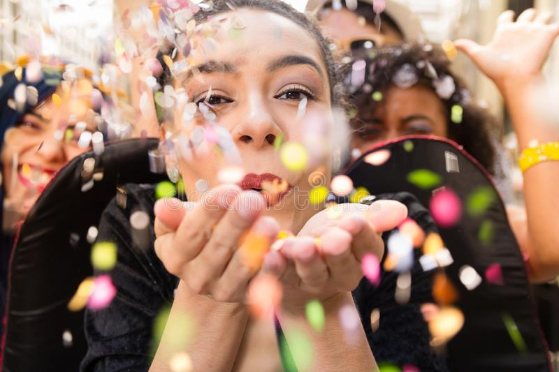 Carnaval party. Dressed group of Brazil people in the city Carnival. Brazilian woman celebrating in parade festival stock photography