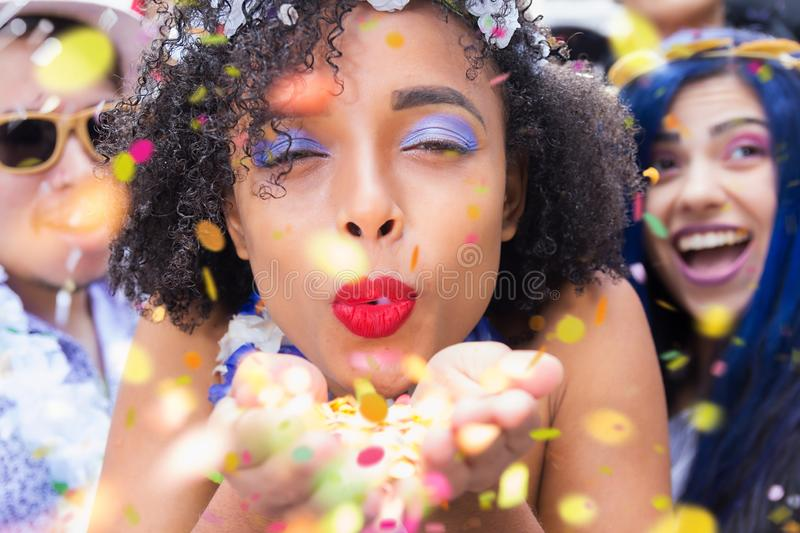 Carnaval party. Dressed group of Brazil people in the city Carnival. Brazilian woman in costume celebrating stock photo