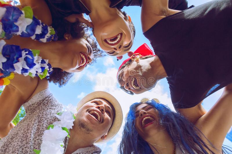 Carnaval party. Dressed group of Brazil people going to street Carnival. Happy brazilian in costume celebrating in parade festival royalty free stock images