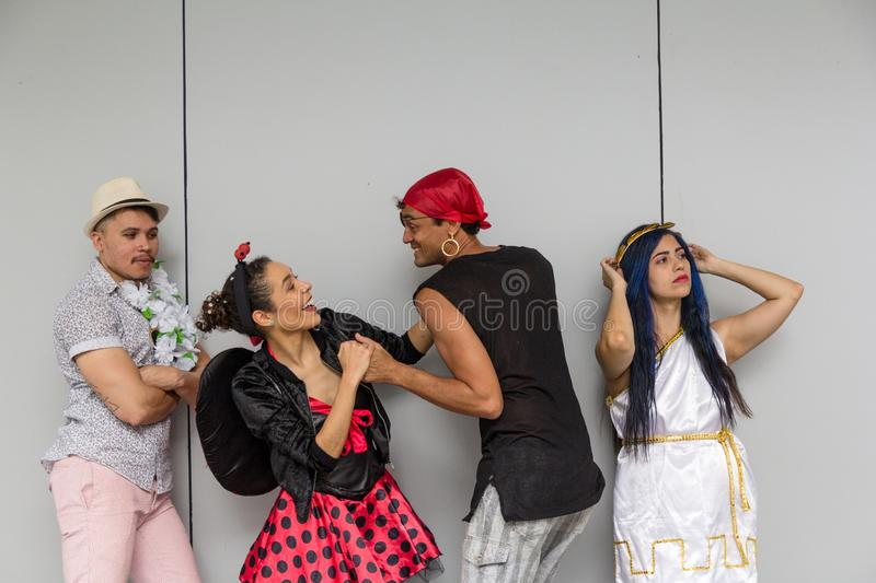 Carnaval party. Dressed Brazil people going to street Carnival. Happy brazilian in costume celebrating in parade festival royalty free stock images