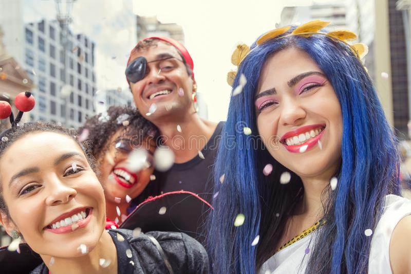 Carnaval party. Dressed group of Brazil people going to street Carnival. Happy revelers in costume celebrating in parade festival. Carnaval party. Dressed group stock images