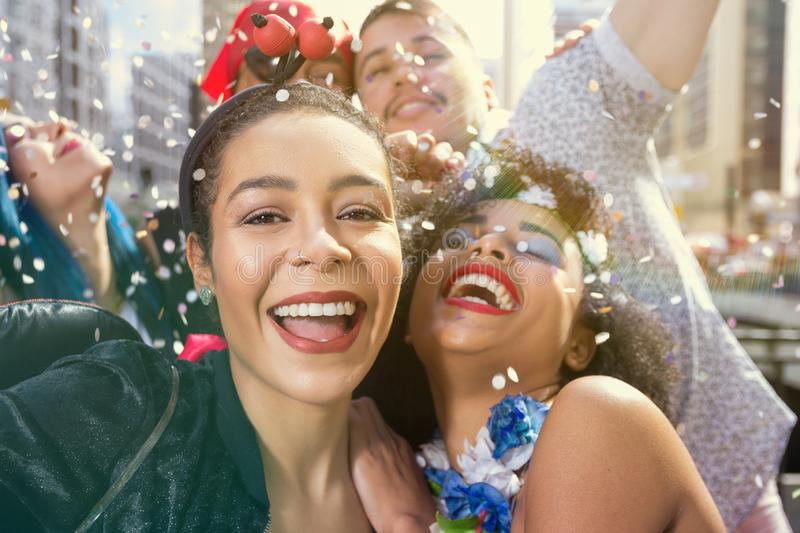 Carnaval party. Dressed group of Brazil people in the street Carnival. Dressed revelers celebrating in parade festival stock photography