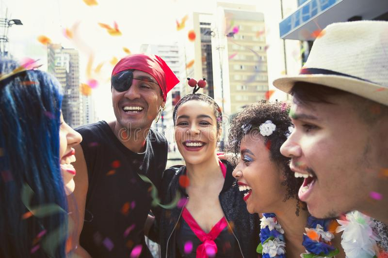 Carnaval party. Group of Brazil friends in costume in the street Carnival. Brazilian partygoers celebrating in parade festival stock photo