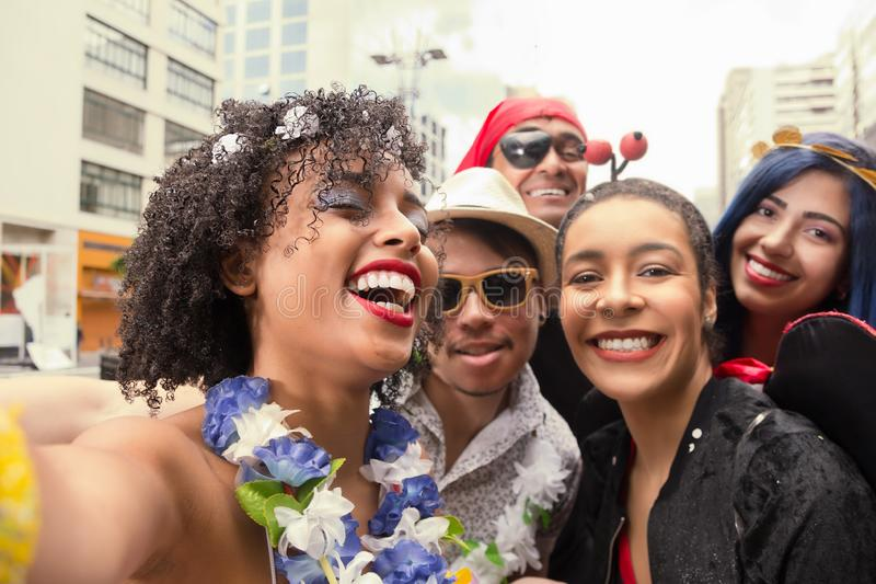 Carnaval party. Group of Brazil friends in the street Carnival. Dressed brazilian revelers having fun in parade festival stock image