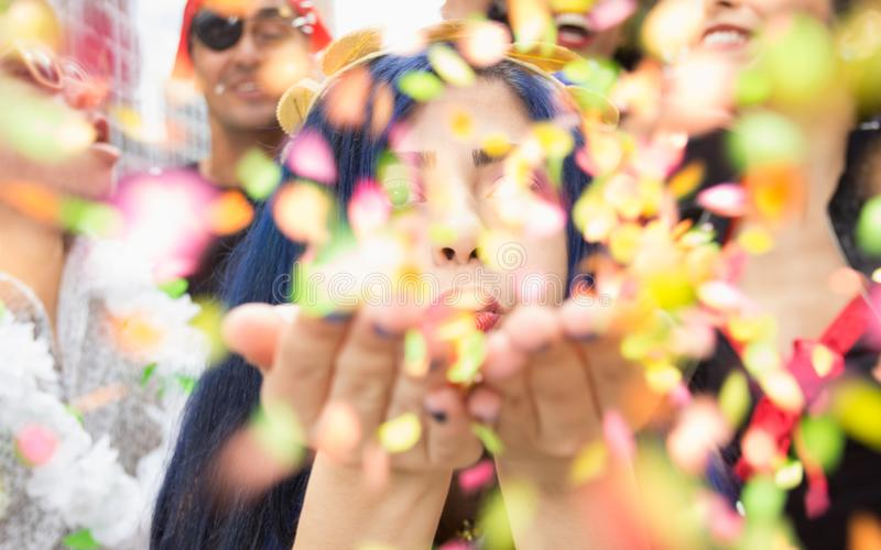 Carnaval party. Group of Brazil people in costume celebrating carnival in the city. Brazilian woman having fun in parade festival royalty free stock photography