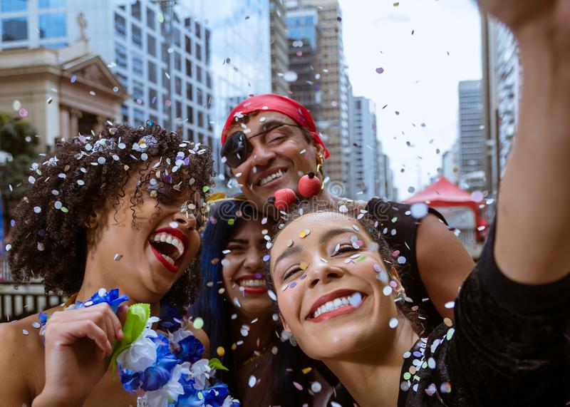 Carnaval party. Group of Brazil people in costume celebrating carnival in the city. Dressed brazilian having fun in parade stock image