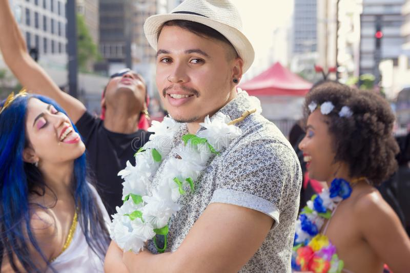 Carnaval party. Group of Brazil people in costume celebrating carnival in the city. Man in costume in the street Carnival royalty free stock photos