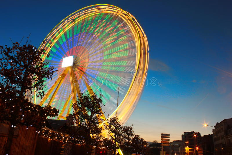 Carnaval wheel in Christmas market. Christmas market in the sunset showing a big lighted wheel stock photography