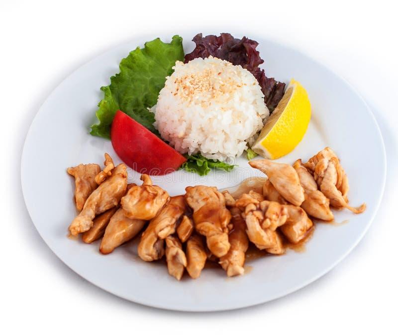 Carne, arroz blanco y verduras y limón asados foto de archivo libre de regalías