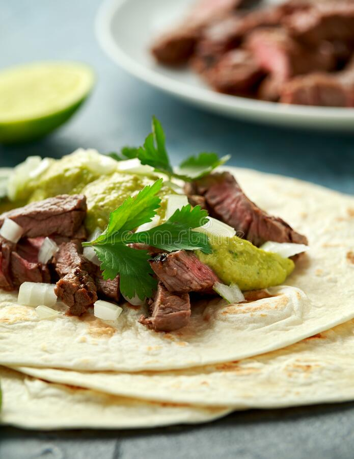 Free Carne Asada Tacos With Grilled Steak, Green Sauce And Onion. Mexican Food Stock Photos - 173482403