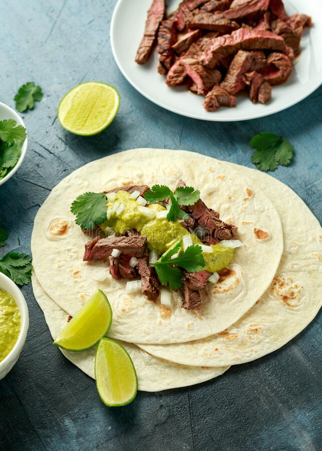 Free Carne Asada Tacos With Grilled Steak, Green Sauce And Onion. Mexican Food Royalty Free Stock Photography - 174193317