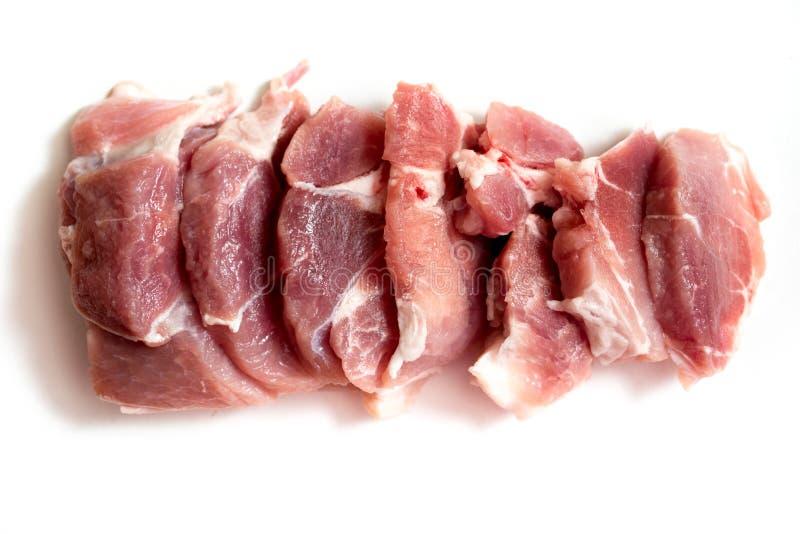Carne crua fresca em um fundo branco Carne da carne de porco ou da carne antes de cozinhar Cozimento do bife imagens de stock royalty free