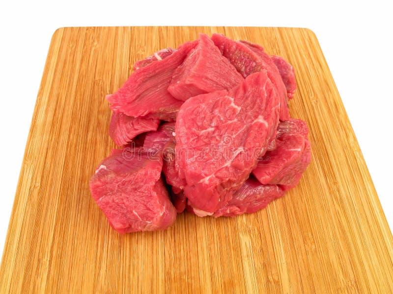 Carne crua fresca na placa de estaca foto de stock