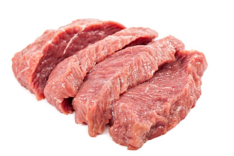 Carne cruda fresca su un fondo bianco fotografia stock