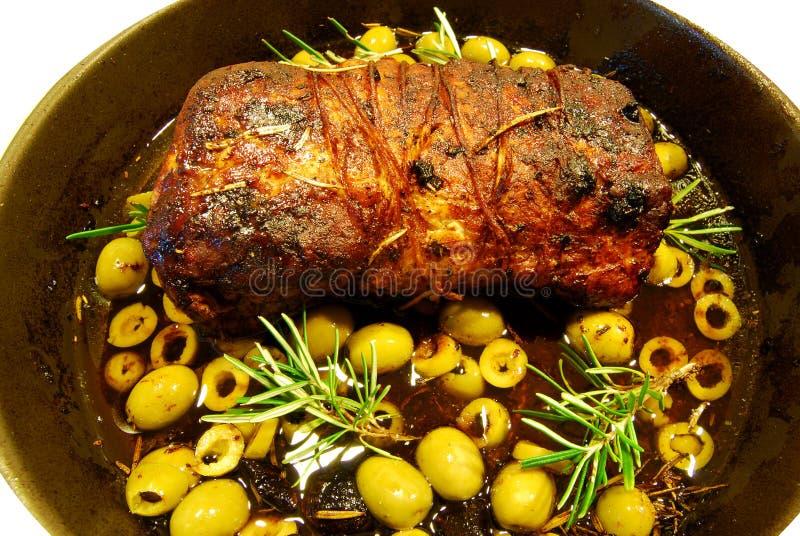 Carne de porco do assado com azeitonas fotos de stock