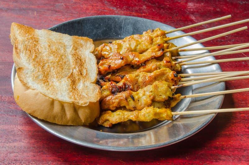 Carne de porco satay com molho foto de stock royalty free