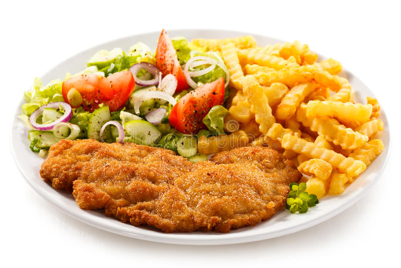 Carne e batatas fritas fritadas fotos de stock royalty free