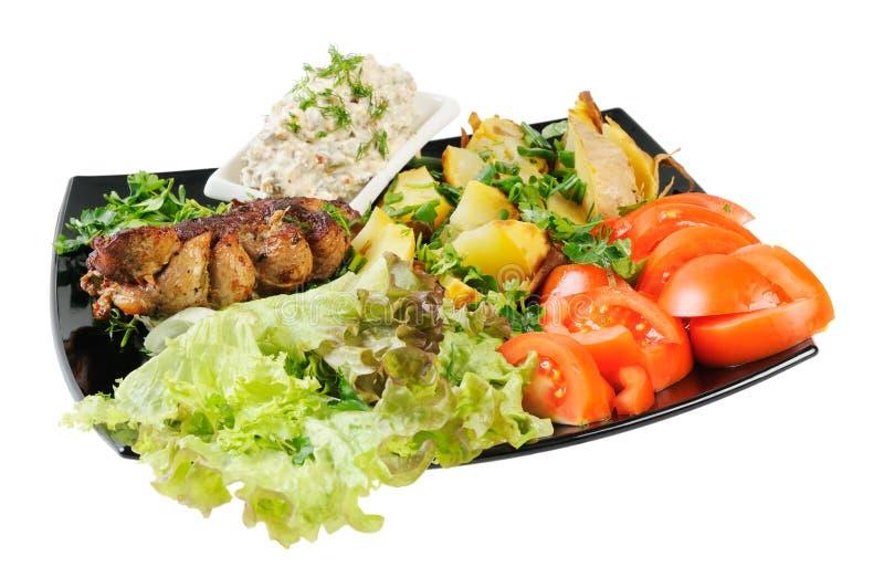 Carne e batatas grelhadas foto de stock
