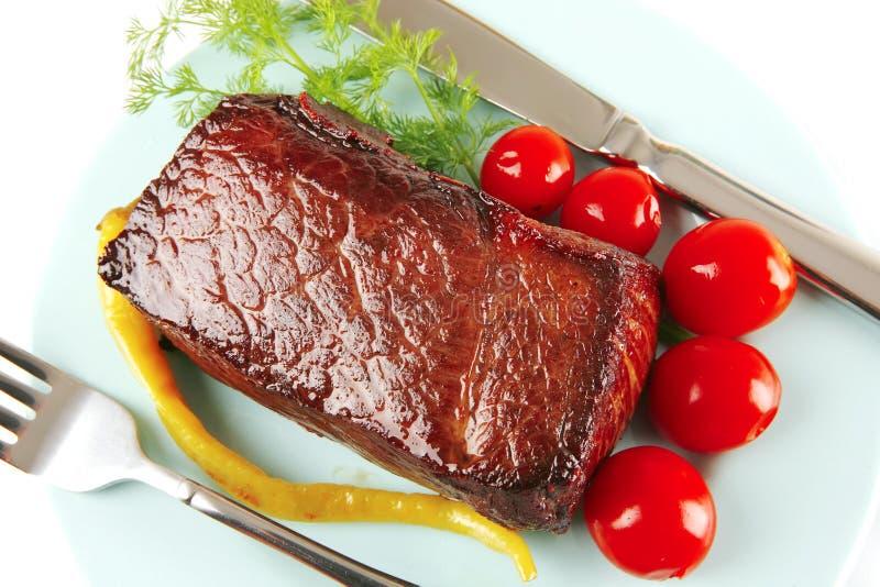 Carne e tomates da carne fotografia de stock