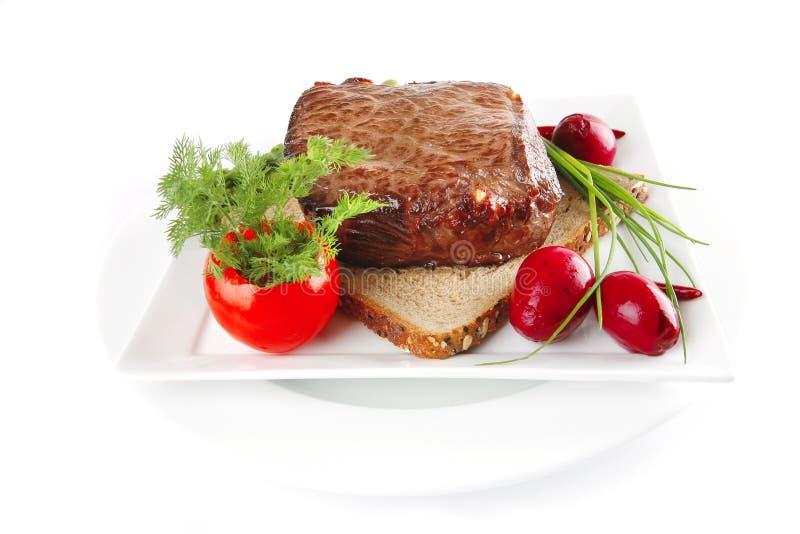 Carne en el pan imágenes de archivo libres de regalías