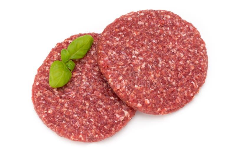 Carne fresca cruda dell'hamburger isolata su bianco fotografie stock libere da diritti