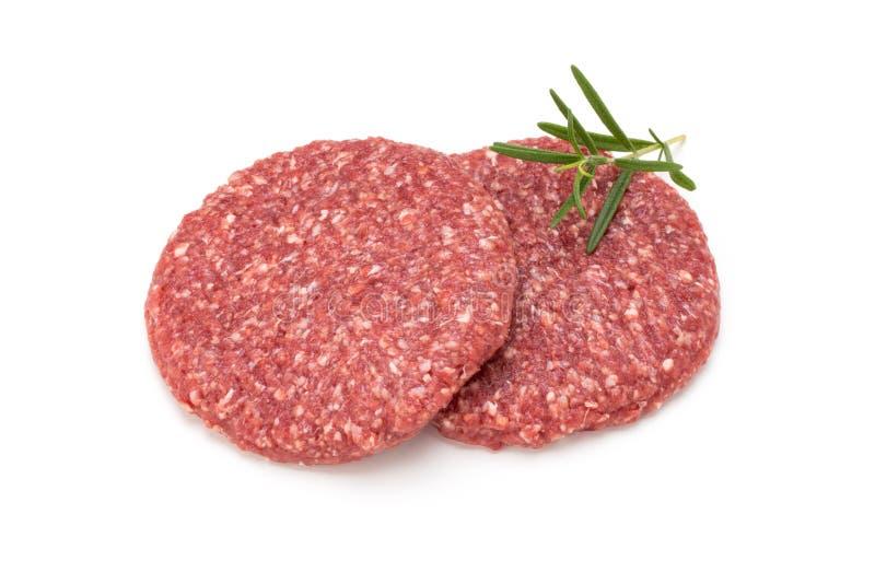 Carne fresca cruda dell'hamburger isolata su bianco fotografia stock libera da diritti