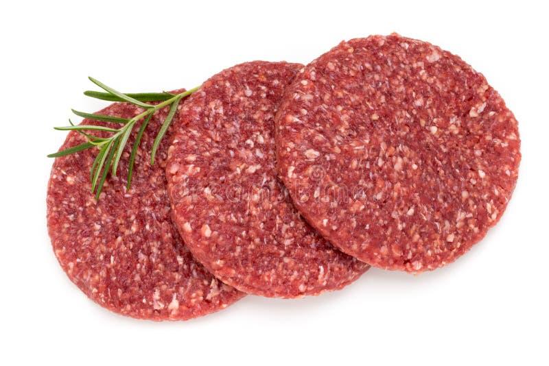 Carne fresca cruda dell'hamburger su bianco fotografia stock libera da diritti