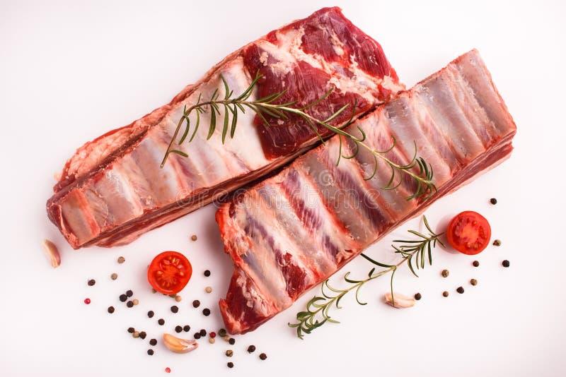 Carne fresca do cordeiro em um fundo branco fotografia de stock royalty free