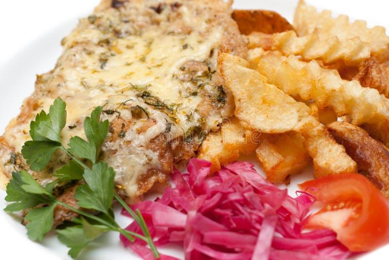 Carne fritta in formaggio e patate fusi fotografia stock libera da diritti