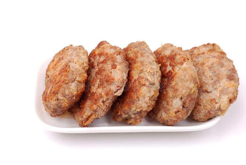 Carne grelhada em uma placa imagem de stock