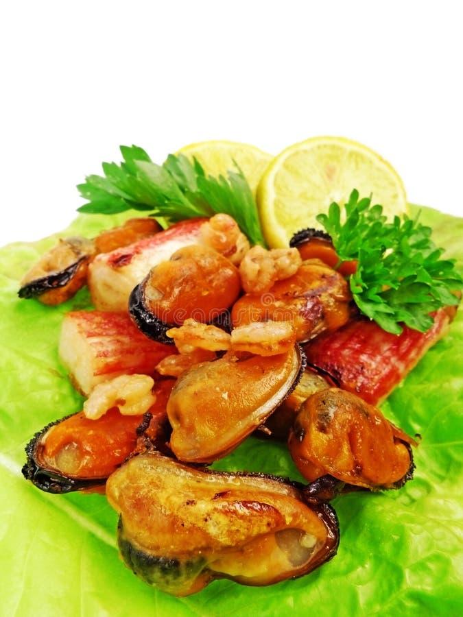 Carne, mitili e gamberi cotti di granchio vicino in su immagine stock libera da diritti