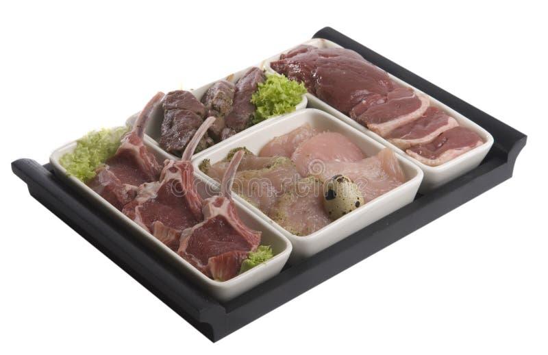 Carne su una zolla fotografia stock