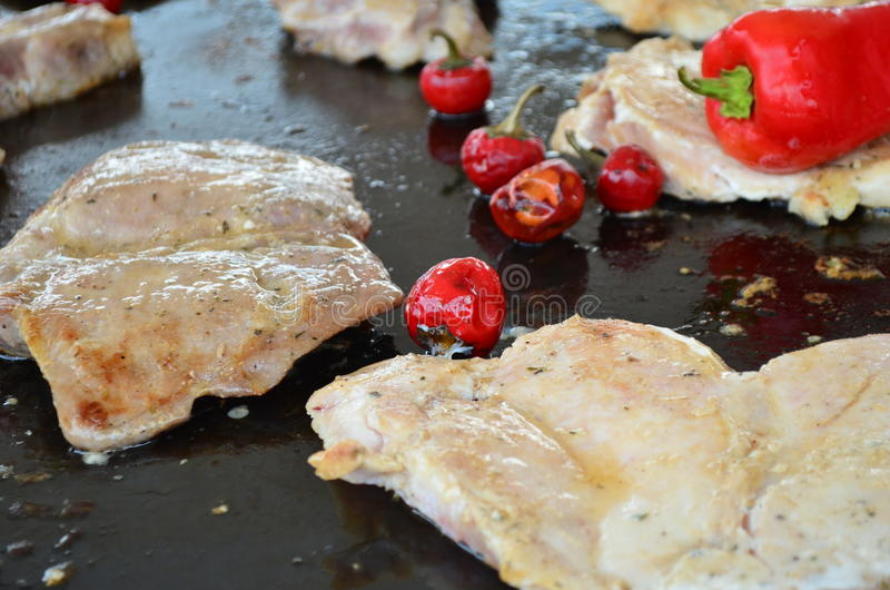 Carne suina arrostita con i peperoni fotografie stock