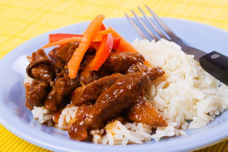 Carne suina cinese con riso immagine stock