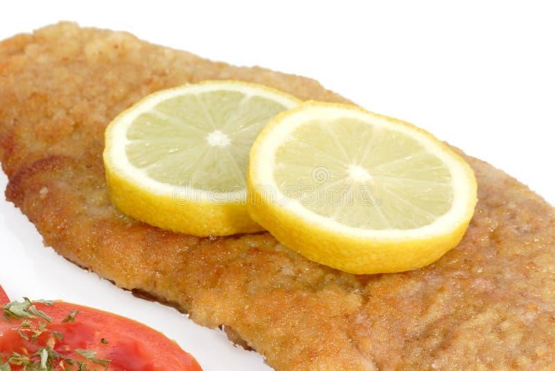 Carne suina con la fetta del limone fotografie stock