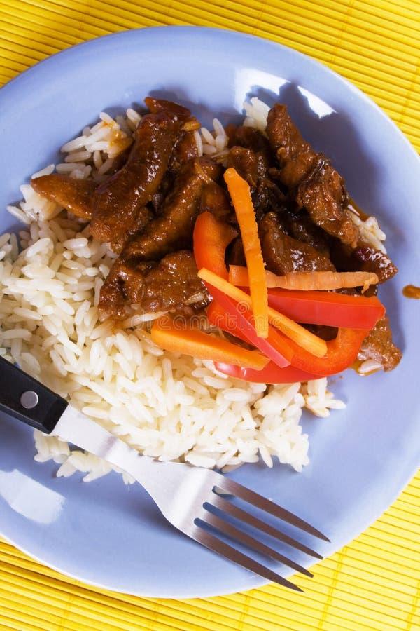 Carne suina con riso fotografie stock