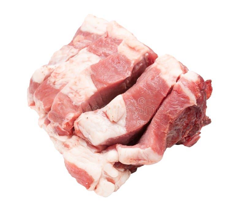 Carne suina su un fondo bianco fotografia stock libera da diritti
