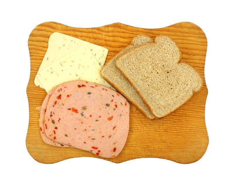 Carne y queso del pan del trigo foto de archivo