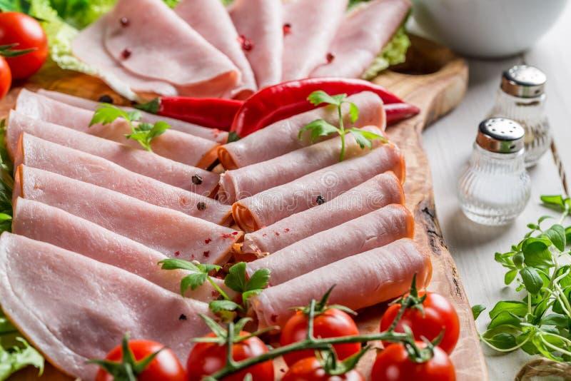 Carnes frías ahumadas con pimienta e hierbas fotos de archivo libres de regalías