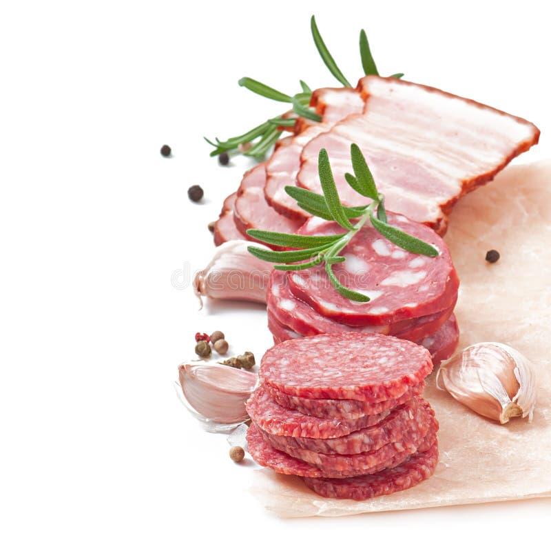 Carnes, romero y pimienta clasificados de la tienda de delicatessen fotos de archivo libres de regalías