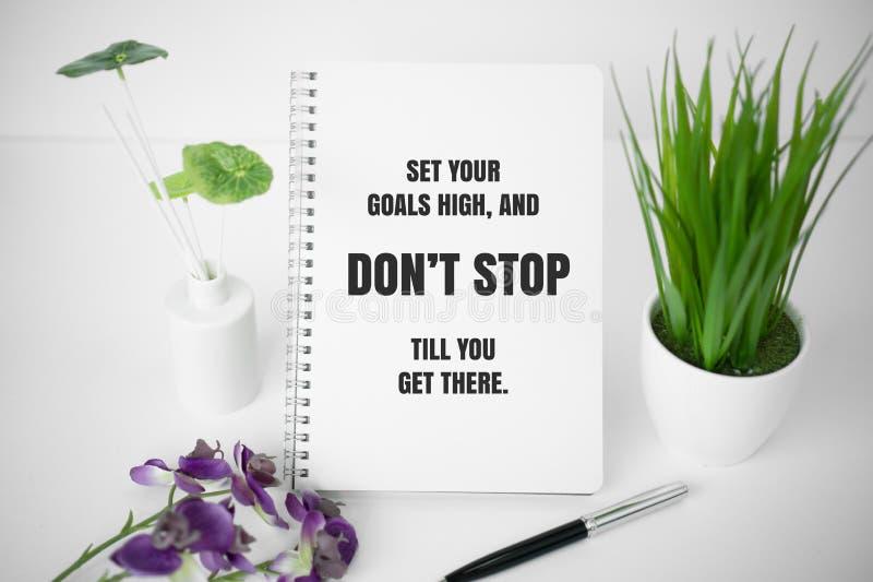 Carnet avec la citation de motivation photo stock