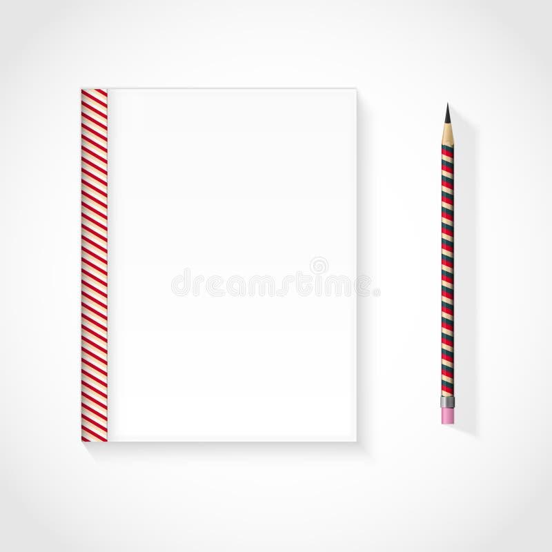 Carnet blanc avec le crayon photographie stock