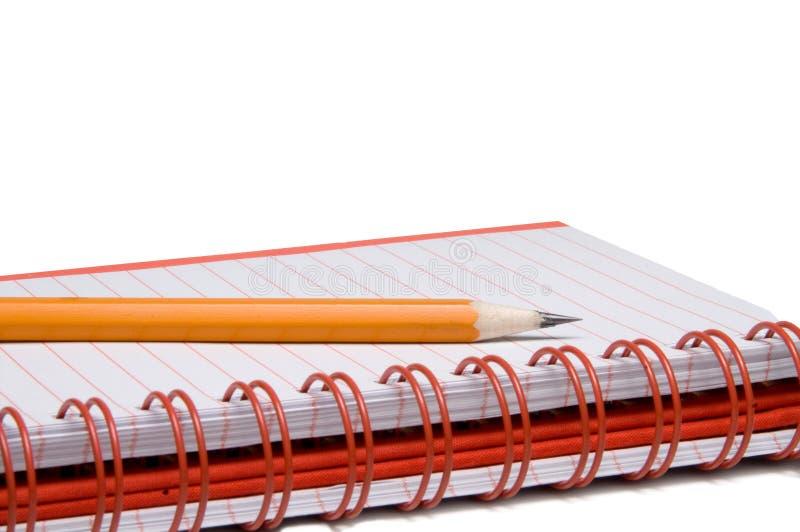 Carnet de notes à spirale et crayon photos stock